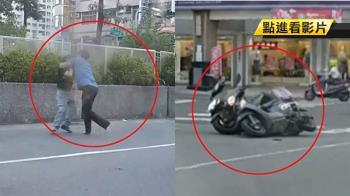 疑行車糾紛 2男拿安全帽互毆爆全武行