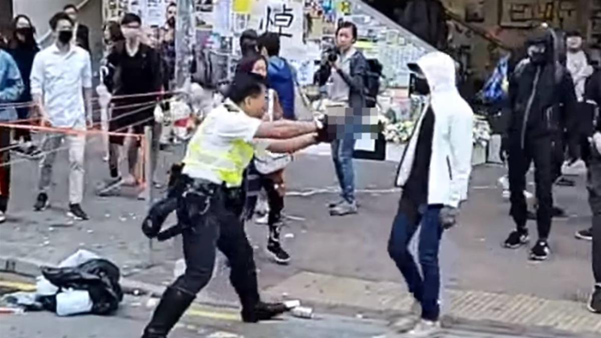 香港西灣河開槍:警察以實彈近距離擊中黑衣人