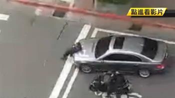 疑與女老闆爭BMW!男人肉擋車險遭輾