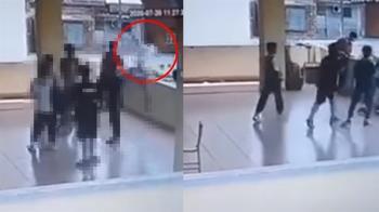 驚悚畫面曝!男學生走廊後仰跳投 下秒倒飛出欄杆墜樓