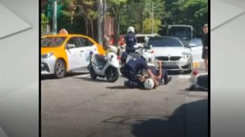 獨/BMW左轉撞警用機車 綠燈直行員警摔飛