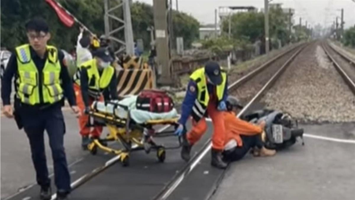 翁騎車暈倒自摔躺平交道 自強號司機員百米前急煞停