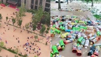 鄭州暴雨「康師傅倉庫坍塌」30萬瓶飲料沖上街!民眾涉水瘋搶