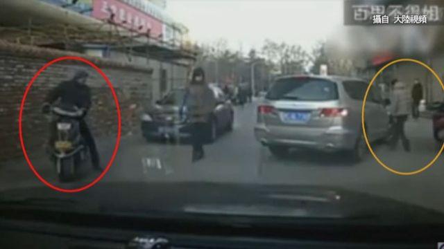 假車禍誘車主下車察看 同夥趁機偷包