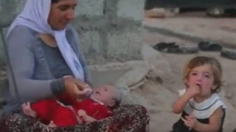 【影片】19名少女拒「服侍」遭ISIS關鐵籠燒死