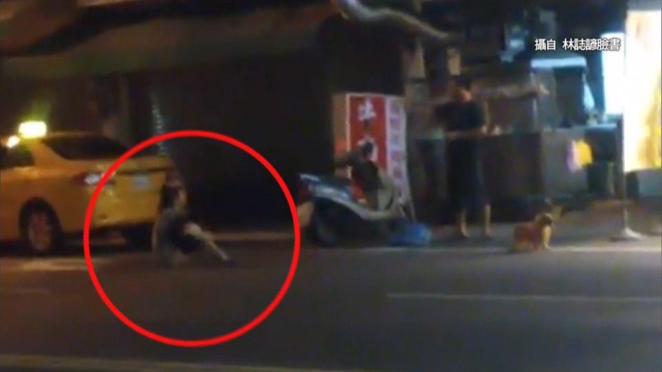 醉女深夜賴坐馬路上 店家憂被車撞苦勸