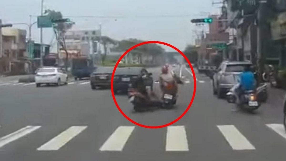 疑邊騎車邊講電話 騎士擦撞自摔險爆頭